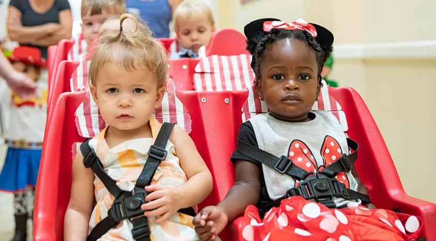 preschoolers in red buggy