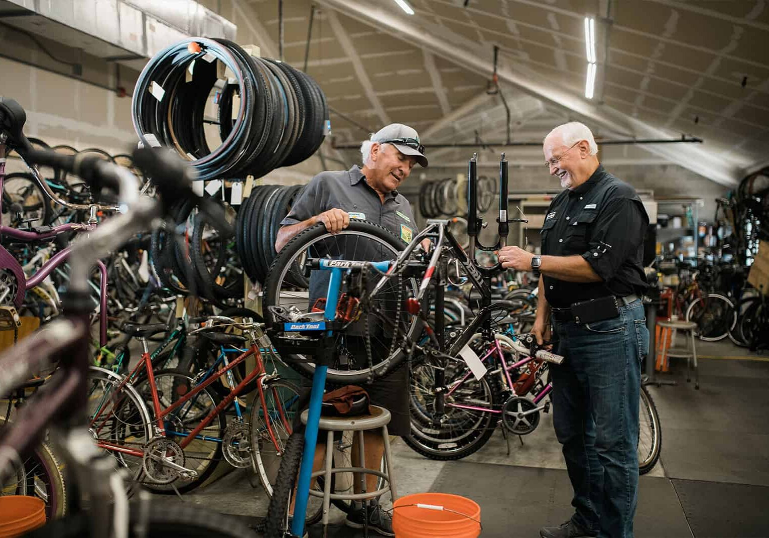 men working on bikes for the pedal power group at fpc